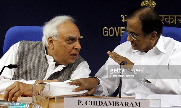 'NEW DELHI INDIA SEPTEMBER 28 IT Minister Kapil Sibal and Finance Minister P Chidambaram addressing a press conference on Supreme Court judgment on...