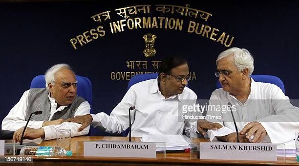 'NEW DELHI INDIA SEPTEMBER 28 IT Minister Kapil Sibal Finance Minister P Chidambaram and Law Minister Salman Khursheed addressing a press conference...