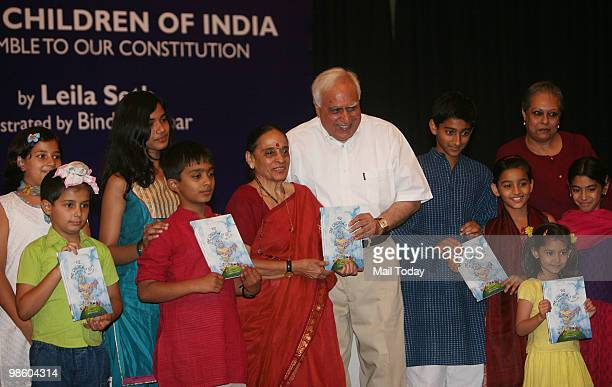 Minister Kapil Sibal with author Leila Seth at the launch of the book We The Children Of India The Preamble To Our Constitution in New Delhi on April...