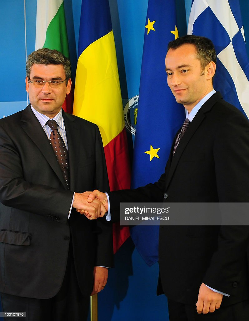 Minister of Bulgarian Foreign Affairs Nickolay Mladenov (R) shakes hands with Romanian Foreign Minister Teodor Baconschi in Bucharest on May 21, 2010 at the beginning of the seventh tri-lateral Foreign Ministers meeting between Romania, Greece, and Bulgaria.