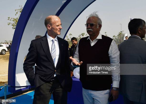 Minister of Civil Aviation Ashok Gajapathi Raju with Tom Enders chief executive officer of Airbus Group NV attends the groundbreaking ceremony for...