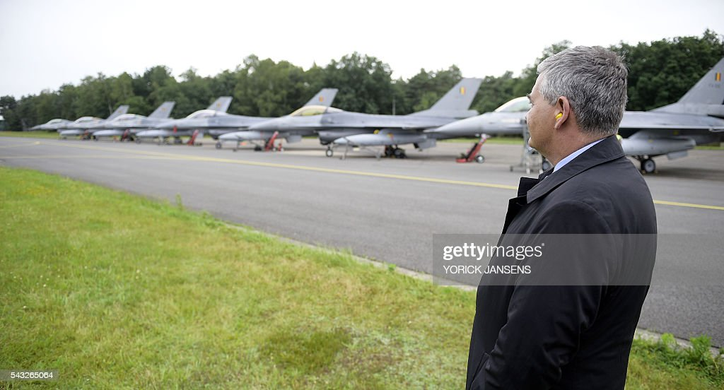 Minister of Defence and Public Service Steven Vandeput looks at the departure of six planes of the Belgian army, F-16 fighter jets on June 27, 2016 at themilitary airbase in Kleine Brogel, Peer to participate in the Operation Guardian Falcon (ODF) as part of the international mission against Islamic State (IS) in Middle East / AFP / BELGA / YORICK JANSENS / Belgium OUT