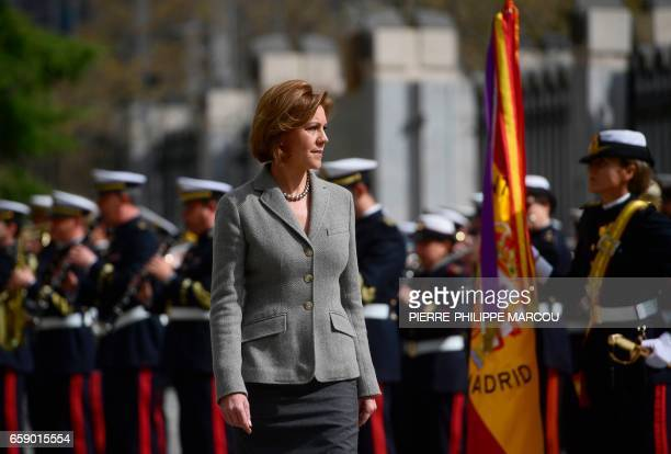 Minister of Defence Maria Dolores de Cospedal reviews the troops in Madrid on March 28 2017 during the swearingin ceremony of Spain's new chief of...