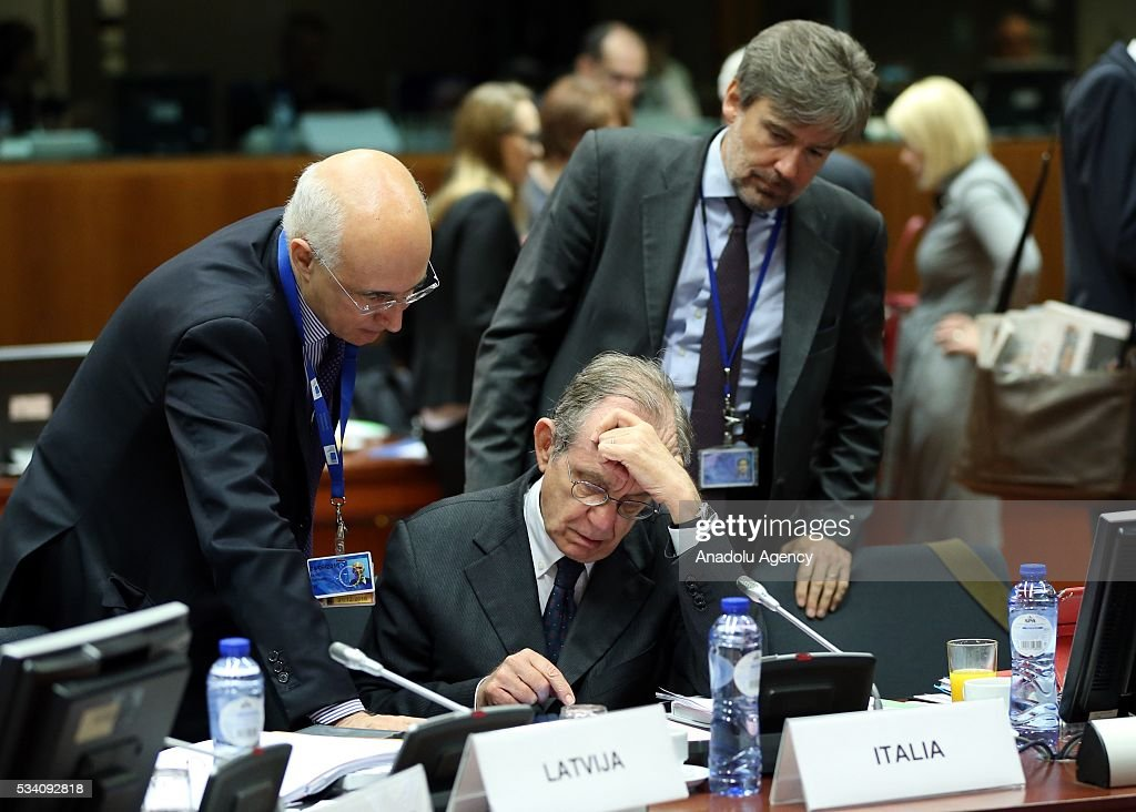 Minister of Economy and Finances of Italy, Pietro Carlo Padoan (C) attends EU economic and financial council meeting, in Brussels, Belgium on May 25, 2016.