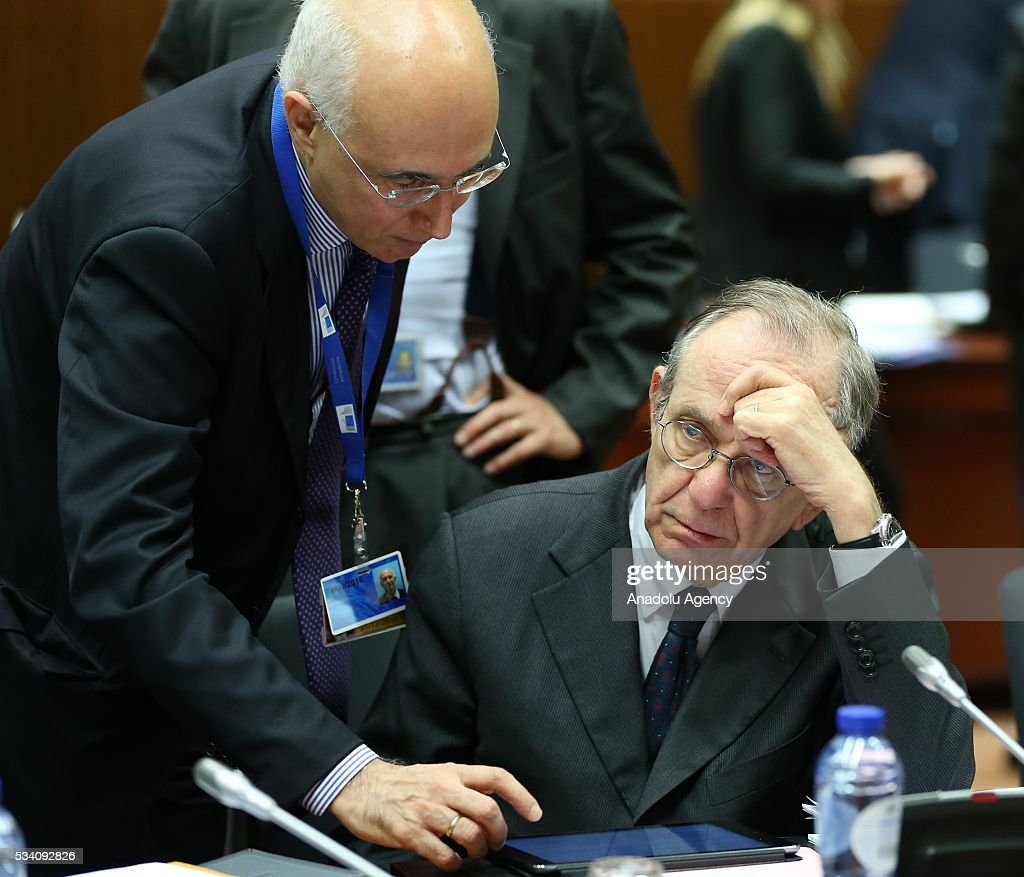 Minister of Economy and Finances of Italy, Pietro Carlo Padoan (R) attends EU economic and financial council meeting, in Brussels, Belgium on May 25, 2016.