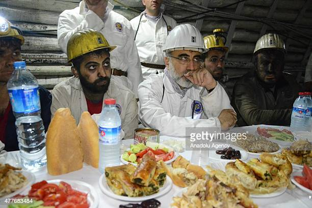 Minister of Energy and Natural Resources of Turkey Taner Yildiz waits with worker before an iftar dinner with miners at a coal mine in northern city...
