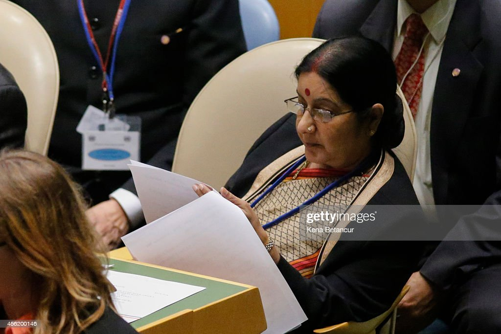 Minister of External Affairs of India <a gi-track='captionPersonalityLinkClicked' href=/galleries/search?phrase=Sushma+Swaraj&family=editorial&specificpeople=2147656 ng-click='$event.stopPropagation()'>Sushma Swaraj</a> listens to a speech by Prime Minister of the Republic of India Narendra Modi at the 69th United Nations General Assembly on September 27, 2014 in New York City. The annual event brings political leaders from around the globe together to report on issues meet and look for solutions.