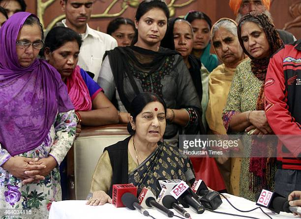 Minister of External Affairs Sushma Swaraj meets the family members of Indian trapped in Iraq at her office on February 21 2015 in New Delhi India...