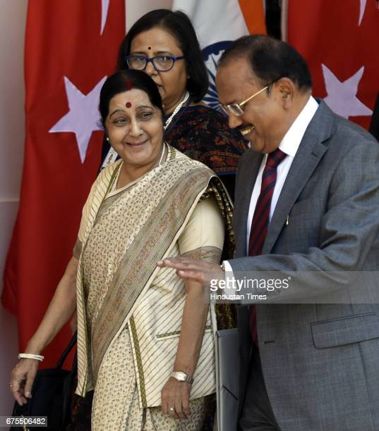 Minister of External Affairs Sushma Swaraj talking to National Security Adviser Ajit Doval during an exchange of agreements at Hyderabad House on May...