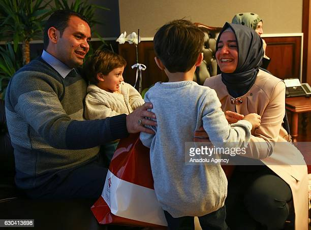 Minister of Family and Social Policy Fatma Betul Sayan Kaya gives presents to brother of Syrian Bana Alabed sevenyearold girl who tweeted on attacks...