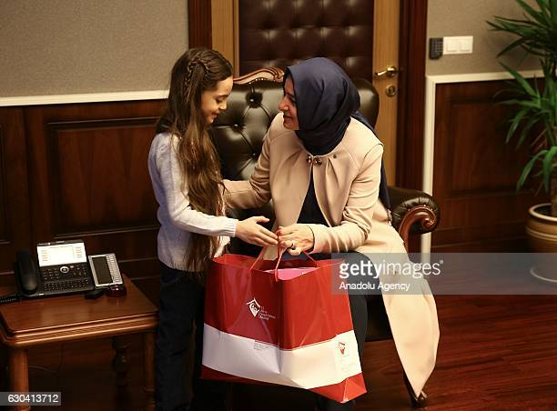 Minister of Family and Social Policy Fatma Betul Sayan Kaya gives presents to Syrian Bana Alabed sevenyearold girl who tweeted on attacks from Aleppo...