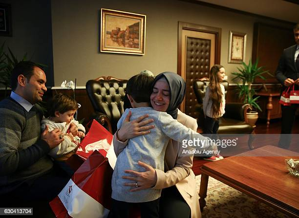Minister of Family and Social Policy Fatma Betul Sayan Kaya hugs brother of Syrian Bana Alabed sevenyearold girl who tweeted on attacks from Aleppo...
