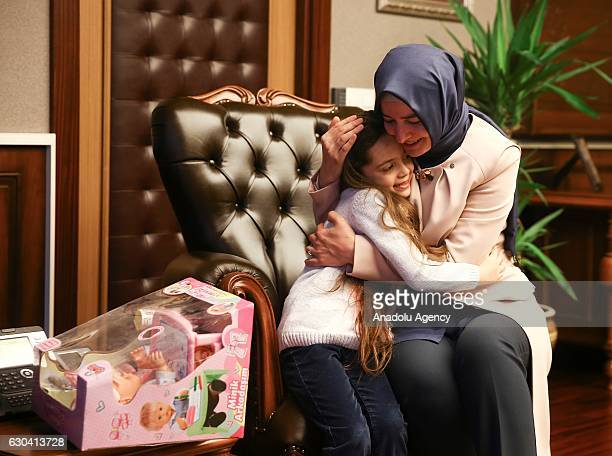 Minister of Family and Social Policy Fatma Betul Sayan Kaya hugs Syrian Bana Alabed sevenyearold girl who tweeted on attacks from Aleppo during their...