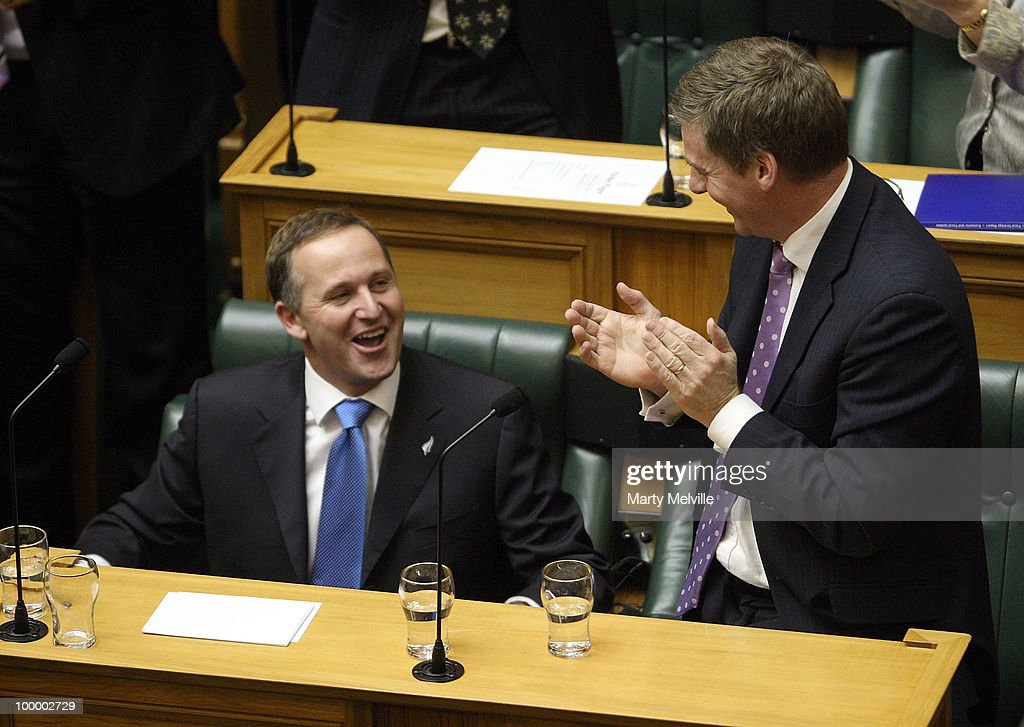 Minister of Finance Bill English congratulates Prime Minister of New Zealand John Key on his speech after the reading of the Budget in Parliament House on May 20, 2010 in Wellington, New Zealand. English announced tax cuts across the board, with all income tax rates to be cut from October this year and company tax rates from April next year.
