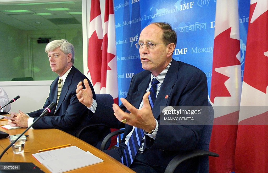 Minister of Finance John Manley and Bank of Canada Governor David Dodge speak to the press during a press conference 28 September 2002 in Washington...