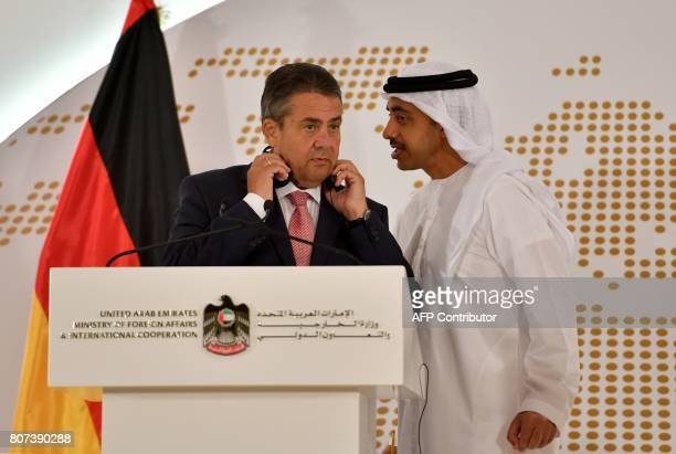 UAE Minister of Foreign Affairs and International Cooperation Abdullah bin Zayed AlNahyan speaks to German Foreign Minister Sigmar Gabriel during a...