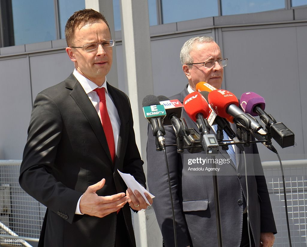 Minister of Foreign Affairs and Trade of Hungary, Peter Szijjarto (R) holds a press conference regarding the Istanbul Ataturk airport attack at Budapest Ferenc Liszt International Airport of Hungary on June 29, 2016.