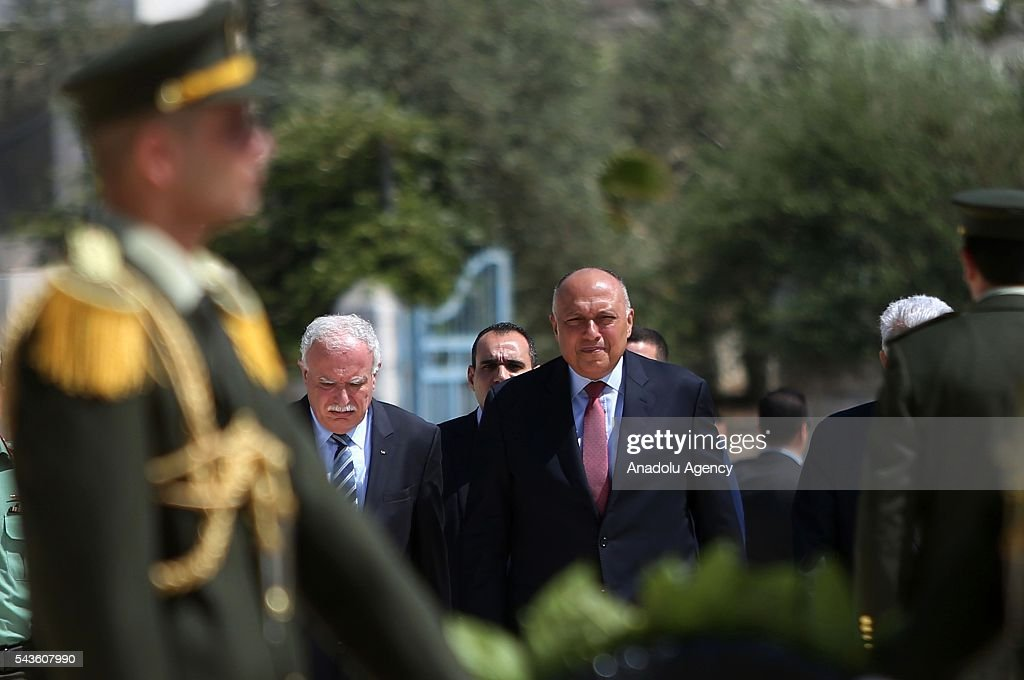 Minister of Foreign Affairs of Egypt, Sameh Hassan Shoukry (R) visits Yasser Arafat's Tomb in Ramallah, West Bank on June 29, 2016.