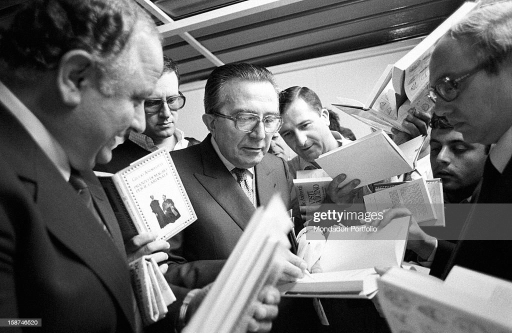Minister of Foreign Affairs of the Italian Republic <a gi-track='captionPersonalityLinkClicked' href=/galleries/search?phrase=Giulio+Andreotti&family=editorial&specificpeople=221669 ng-click='$event.stopPropagation()'>Giulio Andreotti</a> signing autographs on his books during the 7th National Friendship Day. Fiuggi, September 1983