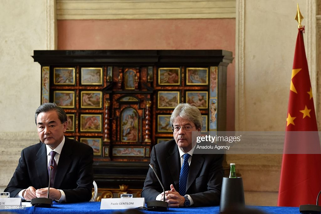 Minister of Foreign Affairs of the People's Republic of China Wang Yi (L) and Italian Minister of Foreign Affairs and International Cooperation Paolo Gentiloni (R) attend a press conference on the Seventh Meeting of the Italy-China Government Committee with in Rome, Italy on May 5, 2016.