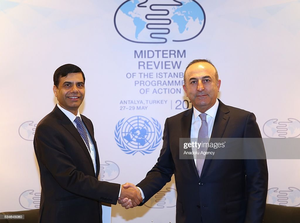 Minister of Foreign Affairs of Turkey, Mevlut Cavusoglu (R) and Under-Secretary-General and High Representative for the LDCs Gyan Chandra Acharya (L) shake hands during the Midterm Review of the Istanbul Programme of Action in Antalya, Turkey on May 27, 2016. The Midterm Review conference for the Istanbul Programme of Action for the Least Developed Countries takes place in Antalya, Turkey from 27-29 May 2016. The conference will undertake a comprehensive review of the implementation of the Istanbul Programme of Action by the least developed countries (LDCs) and their development partners and likewise reaffirm the global commitment to address the special needs of the LDCs.