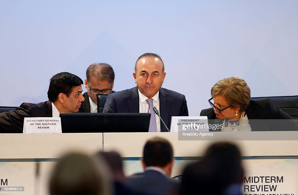 Minister of Foreign Affairs of Turkey, Mevlut Cavusoglu (C) and Under-Secretary-General and High Representative for the LDCs Gyan Chandra Acharya (L) attend the Midterm Review of the Istanbul Programme of Action at Titanic Hotel in Antalya, Turkey on May 27, 2016. The Midterm Review conference for the Istanbul Programme of Action for the Least Developed Countries takes place in Antalya, Turkey from 27-29 May 2016. The conference will undertake a comprehensive review of the implementation of the Istanbul Programme of Action by the least developed countries (LDCs) and their development partners and likewise reaffirm the global commitment to address the special needs of the LDCs.
