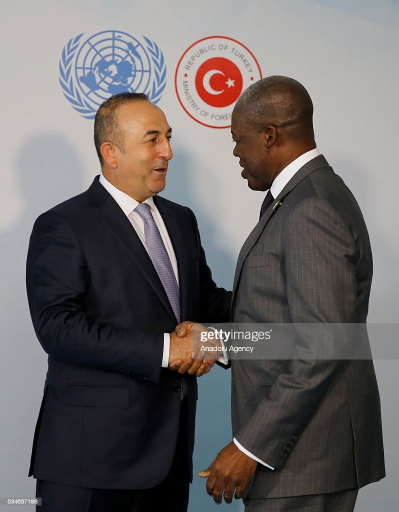 Minister of Foreign Affairs of Turkey, Mevlut Cavusoglu (L) and Vice President of the Republic of Ghana Kwesi Amissah-Arthur (R) shake hands during the Midterm Review of the Istanbul Programme of Action in Antalya, Turkey on May 27, 2016. The Midterm Review conference for the Istanbul Programme of Action for the Least Developed Countries takes place in Antalya, Turkey from 27-29 May 2016. The conference will undertake a comprehensive review of the implementation of the Istanbul Programme of Action by the least developed countries (LDCs) and their development partners and likewise reaffirm the global commitment to address the special needs of the LDCs.