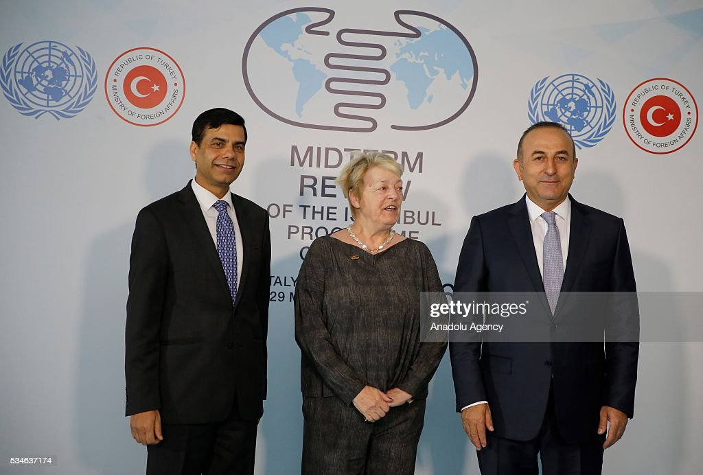 Minister of Foreign Affairs of Turkey, Mevlut Cavusoglu (R), Belgian Minister of State Annemie Neyts-Uyttebroeck (C) and Under-Secretary-General and High Representative for the LDCs Gyan Chandra Acharya (L) pose for a photo during the Midterm Review of the Istanbul Programme of Action in Antalya, Turkey on May 27, 2016. The Midterm Review conference for the Istanbul Programme of Action for the Least Developed Countries takes place in Antalya, Turkey from 27-29 May 2016. The conference will undertake a comprehensive review of the implementation of the Istanbul Programme of Action by the least developed countries (LDCs) and their development partners and likewise reaffirm the global commitment to address the special needs of the LDCs.