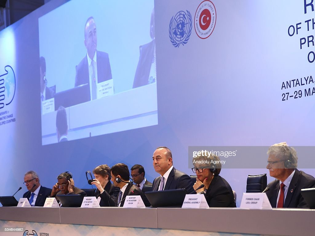Minister of Foreign Affairs of Turkey, Mevlut Cavusoglu (3rd R) makes an opening speech during the Midterm Review of the Istanbul Programme of Action at Titanic Hotel in Antalya, Turkey on May 27, 2016. The Midterm Review conference for the Istanbul Programme of Action for the Least Developed Countries takes place in Antalya, Turkey from 27-29 May 2016. The conference will undertake a comprehensive review of the implementation of the Istanbul Programme of Action by the least developed countries (LDCs) and their development partners and likewise reaffirm the global commitment to address the special needs of the LDCs.