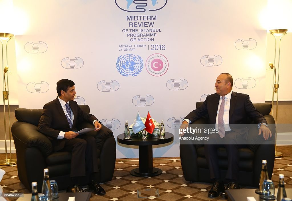Minister of Foreign Affairs of Turkey, Mevlut Cavusoglu (R) meets with Under-Secretary-General and High Representative for the LDCs Gyan Chandra Acharya (L) during the Midterm Review of the Istanbul Programme of Action in Antalya, Turkey on May 27, 2016. The Midterm Review conference for the Istanbul Programme of Action for the Least Developed Countries takes place in Antalya, Turkey from 27-29 May 2016. The conference will undertake a comprehensive review of the implementation of the Istanbul Programme of Action by the least developed countries (LDCs) and their development partners and likewise reaffirm the global commitment to address the special needs of the LDCs.