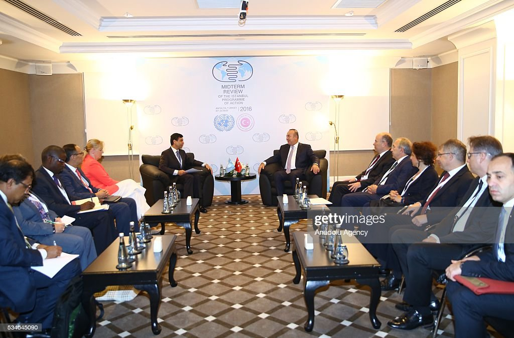 Minister of Foreign Affairs of Turkey, Mevlut Cavusoglu (C-R) meets with Under-Secretary-General and High Representative for the LDCs Gyan Chandra Acharya (C-L) during the Midterm Review of the Istanbul Programme of Action in Antalya, Turkey on May 27, 2016. The Midterm Review conference for the Istanbul Programme of Action for the Least Developed Countries takes place in Antalya, Turkey from 27-29 May 2016. The conference will undertake a comprehensive review of the implementation of the Istanbul Programme of Action by the least developed countries (LDCs) and their development partners and likewise reaffirm the global commitment to address the special needs of the LDCs.