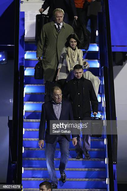 Minister of Foreign Affairs Sergey Lavrov of Russia leads his team out of the plane after arriving at Amsterdam Schiphol Airport to attend the 2014...