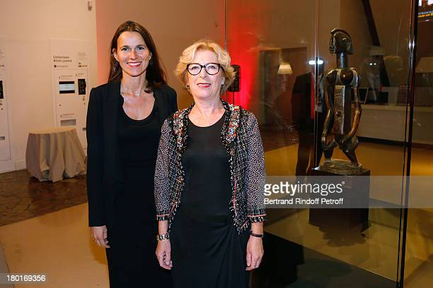 Minister of Higher Education and Research Genevieve Fioraso and Minister of Culture and Communication Aurelie Filippetti front of Dogon feminine...