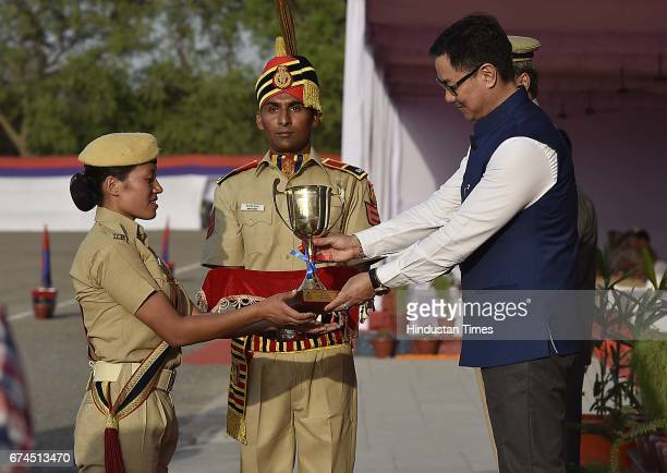 Minister of Home Affairs Kiren Rijiju presents an award to the all rounder Chiewelo Thele at Police training center Jaroda kalan on April 28 2017 in...