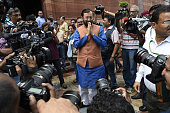 Minister of Human Resource Development Parkash Javadekar arrives to address the media at Parliament House on the opening day of the Monsoon Session...