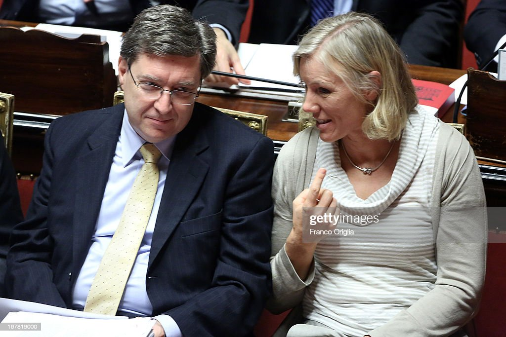 Minister of Labour Enrico Giovannini (L) and Sports Minister <a gi-track='captionPersonalityLinkClicked' href=/galleries/search?phrase=Josefa+Idem&family=editorial&specificpeople=762213 ng-click='$event.stopPropagation()'>Josefa Idem</a> (R) attend the confidence vote at the Senate on April 30, 2013 in Rome, Italy. The new coalition government was formed through extensive cooperation agreements between the right and left coalitions after a two-month long post-election deadlock.