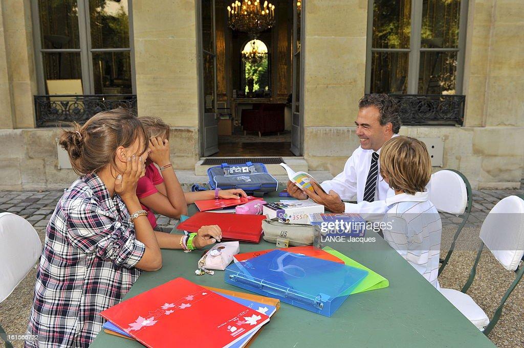 Minister Of National Education <a gi-track='captionPersonalityLinkClicked' href=/galleries/search?phrase=Luc+Chatel&family=editorial&specificpeople=4292995 ng-click='$event.stopPropagation()'>Luc Chatel</a>. Paris, 1er septembre 2011 : Luc CHATEL reçoit 'Paris Match' dans son ministère de l'Education nationale à l'occasion de la rentrée des classes : le ministre avec ses enfants dans les jardins du ministère autour d'une table ou s'empilent les fournitures scolaires : de gauche à droite, ses deux filles, Victorine, 15 ans, et Albane, 13 ans, entrent respectivement en 3e et 4e, et Maxence, 6 ans.