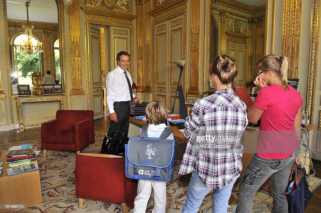 Minister Of National Education <a gi-track='captionPersonalityLinkClicked' href=/galleries/search?phrase=Luc+Chatel&family=editorial&specificpeople=4292995 ng-click='$event.stopPropagation()'>Luc Chatel</a>. Paris, 1er septembre 2011 : Luc CHATEL reçoit 'Paris Match' dans son ministère de l'Education nationale à l'occasion de la rentrée des classes : le ministre avec ses enfants dans son bureau : de droite à gauche, ses deux filles, Albane, 13 ans, et Victorine, 15 ans, entrent respectivement en 4e et 3e, et Maxence, 6 ans, cartable sur le dos, déjà prêt à faire son entrée au CP.