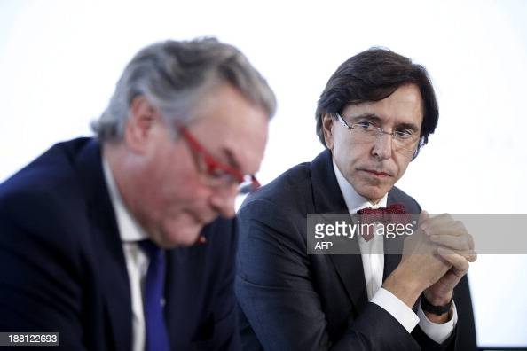 Minister of Public Enterprises and Development Cooperation JeanPascal Labille and Prime Minister Elio Di Rupo give a press conference after a Kern...