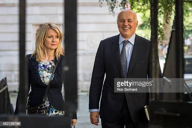 Minister of State for Employment Esther McVey and Secretary of State for Work and Pensions Iain Duncan Smith arrive in Downing Street on July 14 2014...