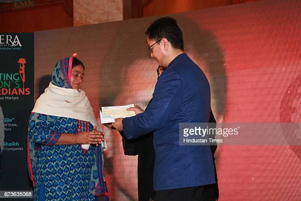 Minister of State for Home Affairs Kiren Rijiju and Dr Nowhera Shaikh CEO Heera Group Of Companies Hyderabad honouring family members of an URI...
