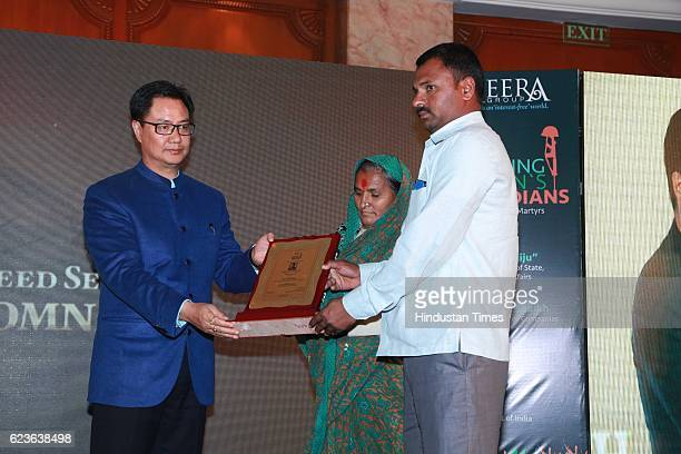 Minister of State for Home Affairs Kiren Rijiju honouring family members of an URI attack victim during an event to salute Nation's Guardians...