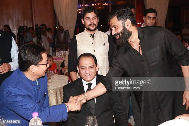 Minister of State for Home Affairs Kiren Rijiju with Mohd Azharuddin and Bollywood actor Suniel Shetty salutes Nation's Guardians during an event...