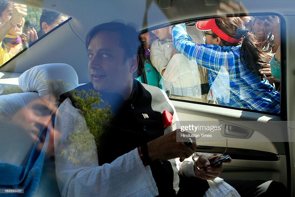 Minister of State for Human Resource Development Shashi Tharoor sitting in his car as BJP workers showed black flags and blocked when he going to a function organised in Talkatora Stadium on the occasion of International Women's Day on March 8, 2013 in New Delhi, India. BJP workers are protesting and shouting slogans against the Delhi Chief Minister Sheila Dikshit government and claimed that Delhi was not a safe city for women and girls.