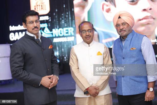 Minister of State for Information Broadcasting Rajyavardhan Singh Rathore Sports Minister Vijay Goel and FDCI President Sunil Sethi during the...