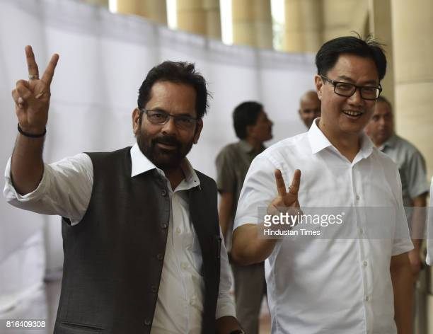 Minister of State for Parliamentary Affairs Mukhtar Abbas Naqvi and Minister of Home Affairs of India Kiran Rijiju after casting their votes during...