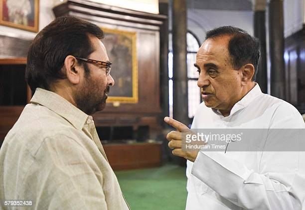 Minister of State for Parliamentary Affairs Mukhtar Abbas Naqvi talking to the member of the Rajya Sabha Subramanian Swamy after paying floral...