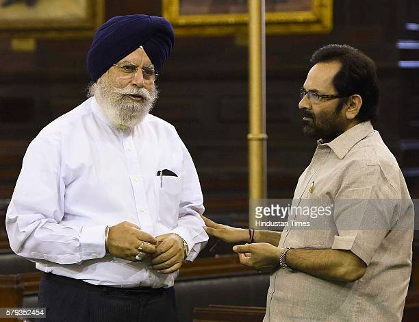 Minister of State for Parliamentary Affairs Mukhtar Abbas Naqvi talking to Minister of State for Agriculture Farmers Welfare SS Ahluwalia after...
