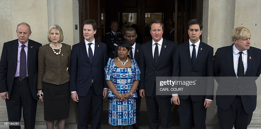Minister of State for Policing and Criminal Justice Damian Green, Home Secretary Theresa May, Deputy Prime Minister Nick Clegg, Doreen and Stuart Lawrence, Prime Minister David Cameron, Labour party leader Ed Miliband and London mayor Boris Johnson pose for a photograph outside St Martin-in-the-Fields Church in central London on April 22, 2013 following a memorial marking the 20th anniversary of the death of Doreen and Stuart Lawrence's son, Stephen. Lawrence, 18, was murdered by a gang of racists who stabbed him as he waited for a bus in Eltham, south-east London on April 22, 1993. PHOTO/CARL COURT