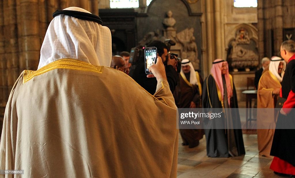 A minister of the Amir takes an image of the Amir of the State of Kuwait as he visits Westminster Abbey to lay a wreath at the grave of the Unknown Warrior on November 29, 2012 in Windsor, England. The Amir has been on a three day State visit to the United Kingdom.